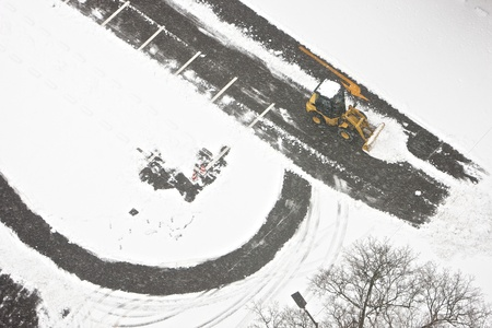 Wheel loader machine removing snow in winter on the road photo