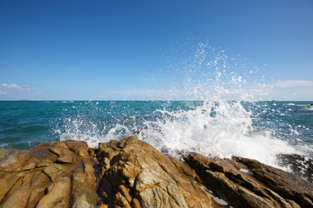 The waves breaking on a stony beach, forming a spray Stock Photo - 14417700