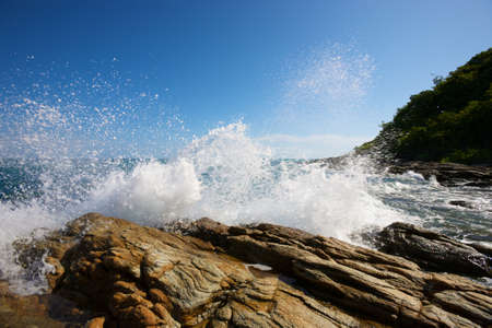 The waves breaking on a stony beach, forming a spray Stock Photo - 14417702