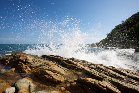 The waves breaking on a stony beach, forming a spray Stock Photo - 14417703