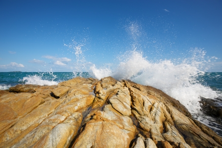 The waves breaking on a stony beach, forming a spray Stock Photo - 14417701