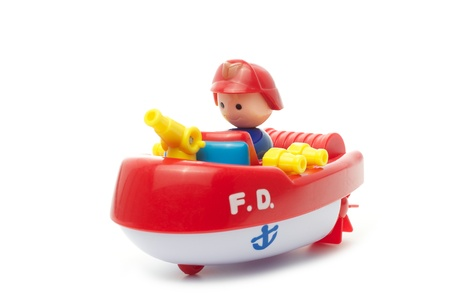 yellow boats: Toy Fire Department boat, Toy FD boat, Toy Firefighter boat, Toy Fireman boat, isolated on white background