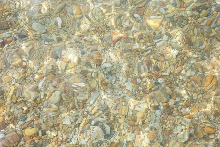 Pebbles under water photo