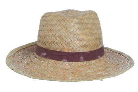 dirty old straw hat isolated on a white background photo