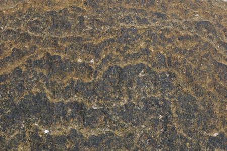 Stone texture with bits of sand on top on Sai Kaew Beach, Samed Island, Thailand photo
