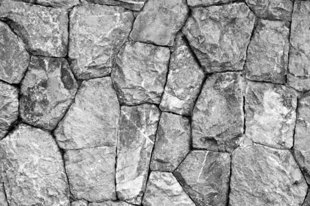 monochrome shot of stone wall texture background photo