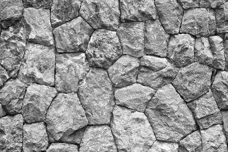 pared rota: disparo monocromo de fondo de piedra textura de la pared Foto de archivo