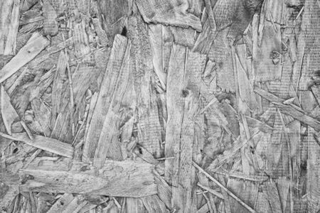 skim: monochrome shot of wooden pressed shavings texture background