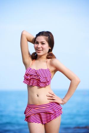 beautiful woman in bikini on the beach at summer day Stock Photo