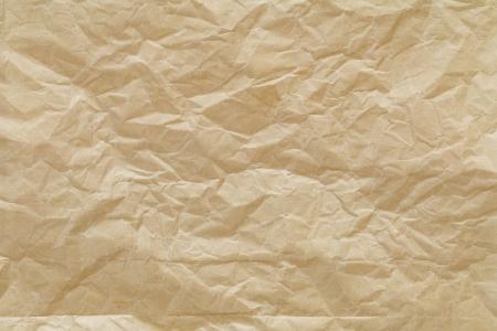 リサイクル紙を丸めて茶色光テクスチャ背景のショットを閉じる 写真素材