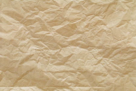 close up shot of light brown crumpled recycled paper texture background Stock Photo