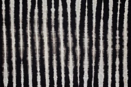 lazo negro: Cierre de tiro de empate tinte fondo textura de la tela