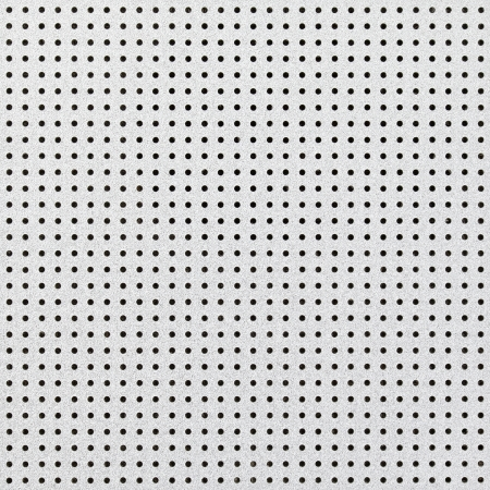 close up shot of aluminium holed or perforated grid texture background. dot pattern photo