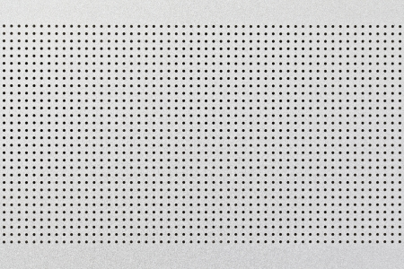 holed: close up shot of aluminium holed or perforated grid texture background  dot pattern