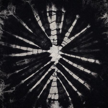 lazo negro: dispararon cerca de tie dye fondo textura de la tela Foto de archivo