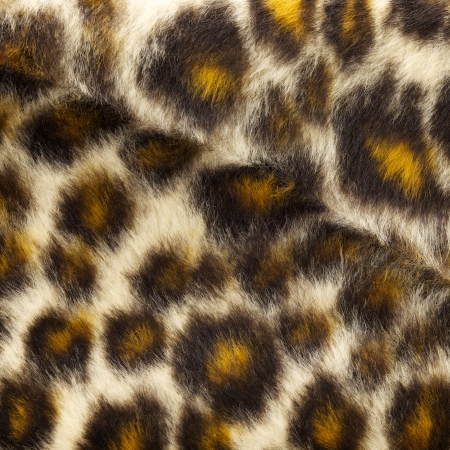 close up shot of fake leopard tiger fur texture background photo