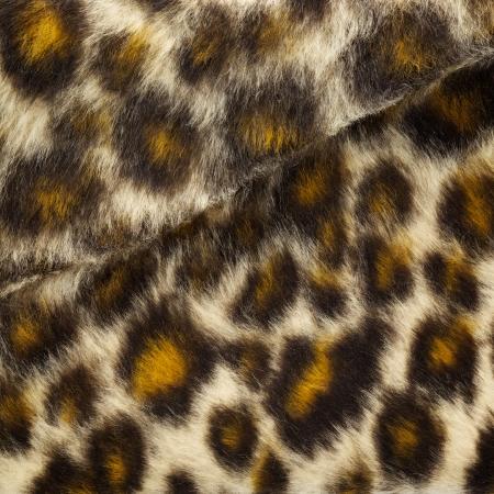 close up shot of fake leopard tiger fur texture background photo