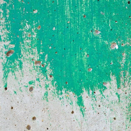 close up shot of an unfinished green paint on plain concrete wall surface texture background photo
