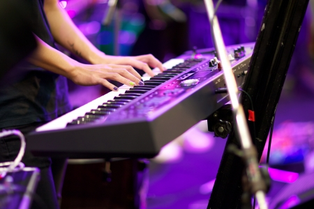 piano player: hands of musician playing keyboard in concert with shallow depth of field Stock Photo