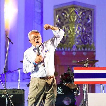 civil disorder: Bangkok, Thailand - January 7, 2014: Peoples Democratic Reform Committee (PDRC) leader Suthep Thaugsuban on January 7, 2014 at Ratchadamnoen stage, Democracy Monument, Bangkok, Thailand.