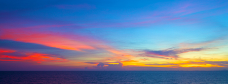 beautiful sunset in the tropical sea at summer time for use as a banner background photo