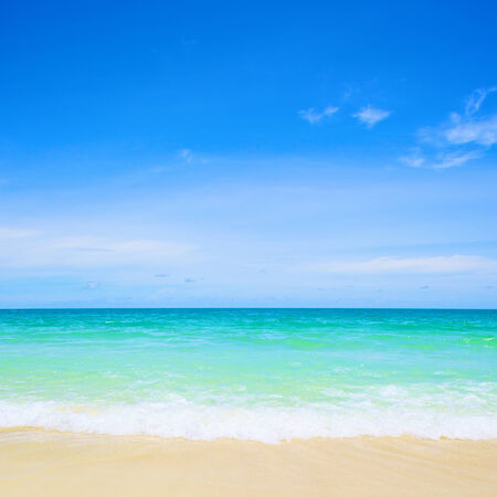 beach and tropical sea under the bright blue sky at summer day photo