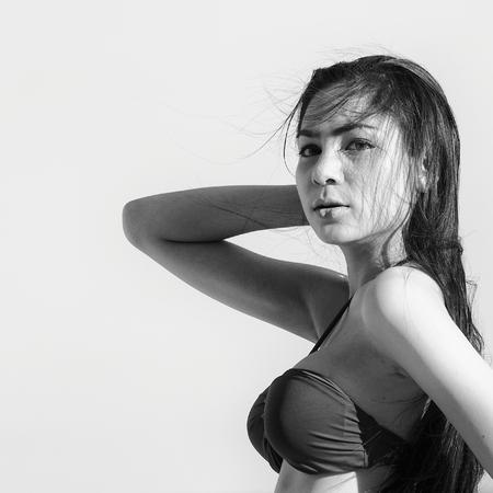 monochrome shot of beautiful woman in bikini on the beach photo