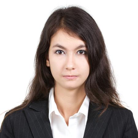 白いシャツと白い背景に、正方形の比に分離したスーツで若い魅力的なセクシーな美しい女性のパスポートの写真 写真素材