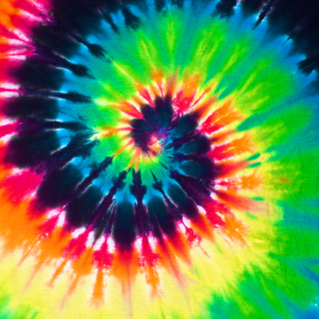 psychedelic background: close up shot of colorful tie dye fabric texture background