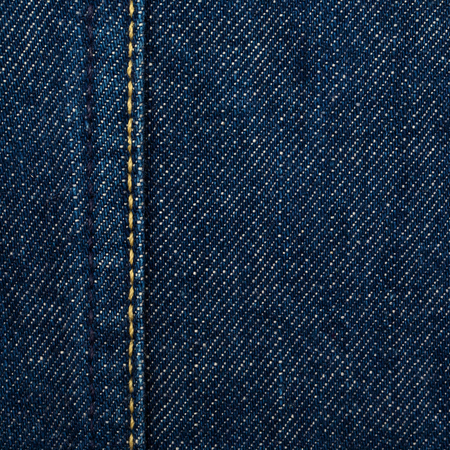 close up shot of raw denim dark wash indigo blue jeans texture background in square ratio Stock Photo