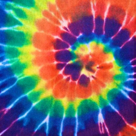 stropdas: close-up shot van kleurrijke tie dye stof textuur achtergrond in vierkante verhouding Stockfoto