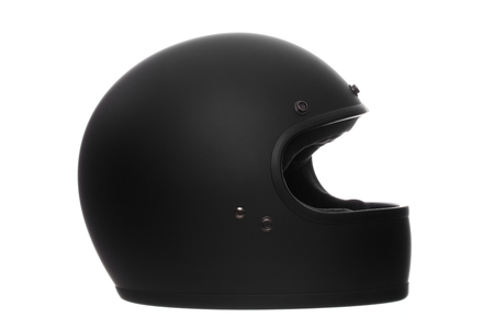 flat or matte black full face motorcycle helmet isolated on a white background