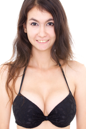 sexy beautiful young woman in bra isolated on a white background 免版税图像