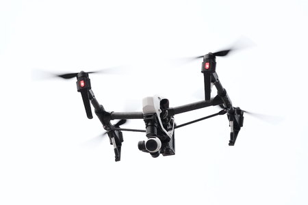 drone flying in white background, from below angle Stock Photo