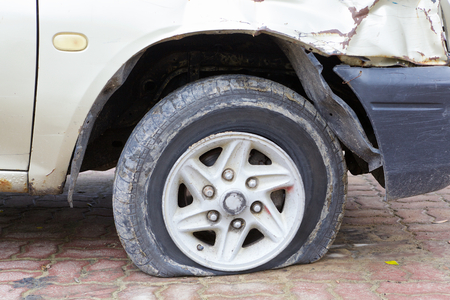 flat tire: close up shot of flat tire waiting for repair