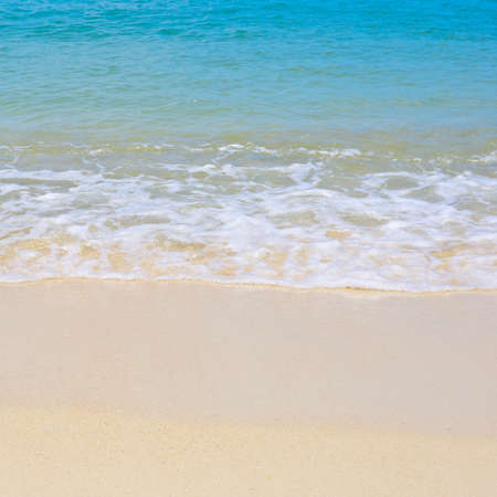 soft wave of the sea on clean sandy beach texture background in square ratio Stock Photo