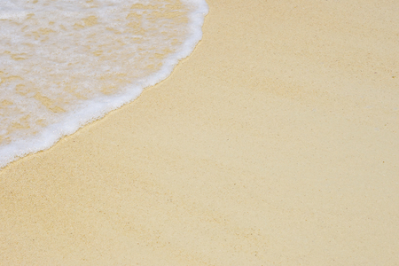 beautiful soft wave of the sea on clean sandy beach texture background Stock Photo