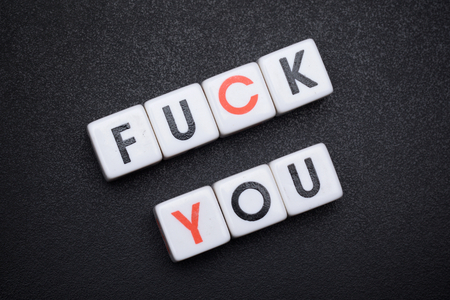 fuck you, close up, macro shot of letter dice spelling fuck you, on black texture background for rude concept, alphabet, type, text, cube, block, crossword, wtf, dirty word, message, fucking