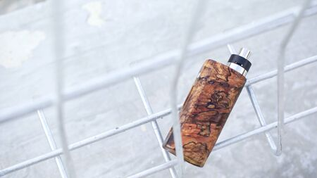 high end natural stabilized wood box mods with rebuildable dripping atomizer, vaping device, selective focus