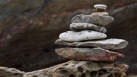 balancing of sea stone, rock, pebble and coral stack tower Banco de Imagens