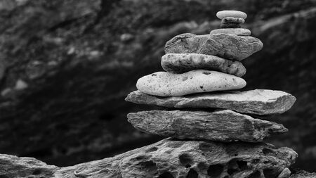 black and white, monochrome shot of balancing of sea stone, rock, pebble and coral stack tower Banco de Imagens