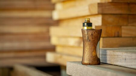 high end rebuildable dripping atomizer with stabilized natural walnut wood regulated box mods, vaping device, selective focus 版權商用圖片