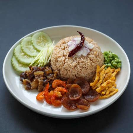 Kkao Kluk Kapi, Thai food, shrimp paste rice with shallot, roasted pepper, cucumber, mango, caramelized pork, dried shrimp, sausage, omelette and yardlong beans