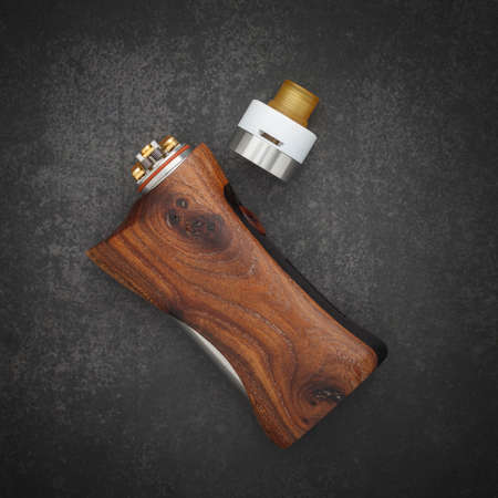 high end rebuildable dripping atomizer with stabilized natural walnut regulated box mods on dark gray, grey, black tone texture background, vaping device, selective focus
