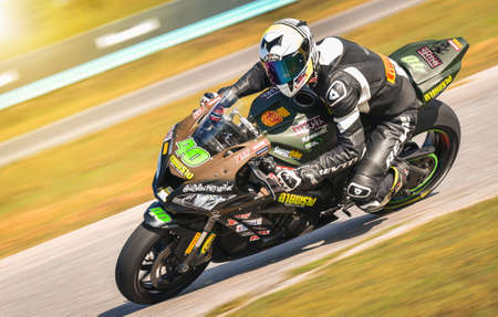 NAKHON PATHOM, THAILAND-DECEMBER 17: Motorcycle racing with the style and excitement of the participating teams in the