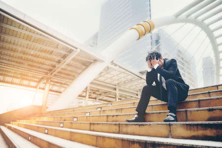 Business man failed to feeling hopeless, distraught, sad and discouraged in life. Concept failing businesses. Stock Photo