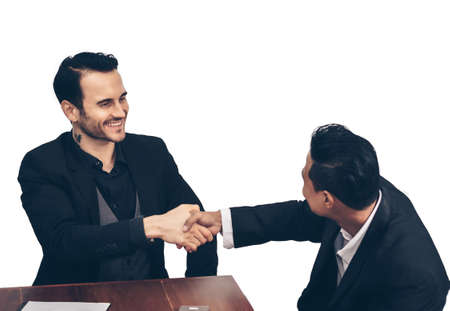Business handshake after a successful business negotiation meeting. Focus on the face