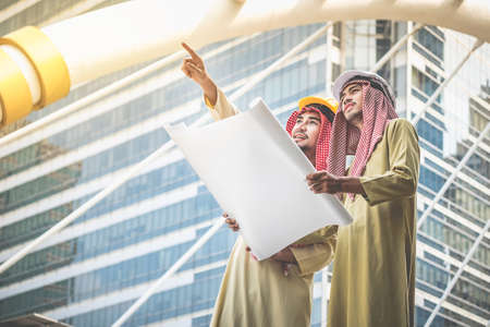 Arab architects and engineers convene to work together for a common goal and success. Stock Photo