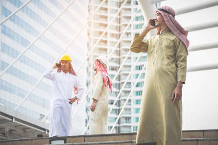 Arab businessmen and conference architects use communication tools to discuss and work together to achieve goals and accomplishments.Business Concept