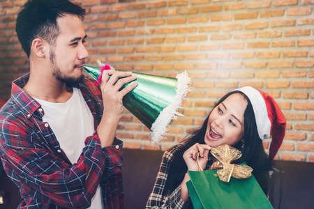 Asian young people enjoy Christmas parties on their holidays. Stock Photo